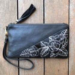 HIDE CARVED ROSE TASSEL CLUTCH
